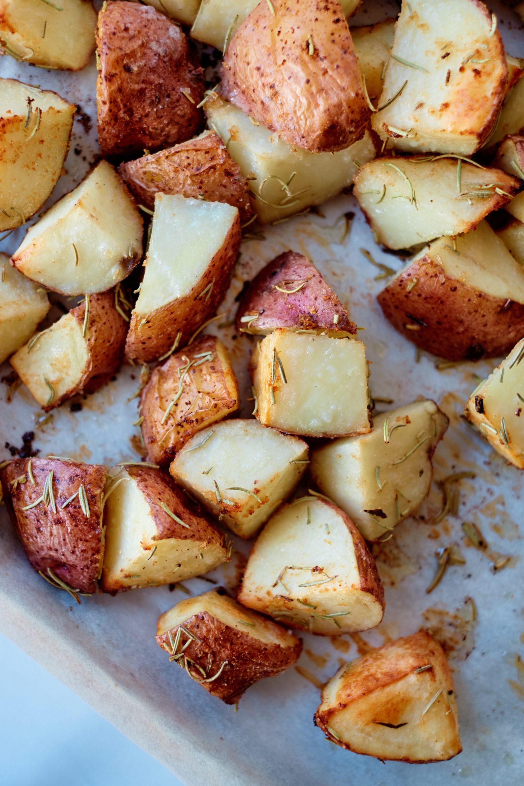 potato chunks on a baking sheet