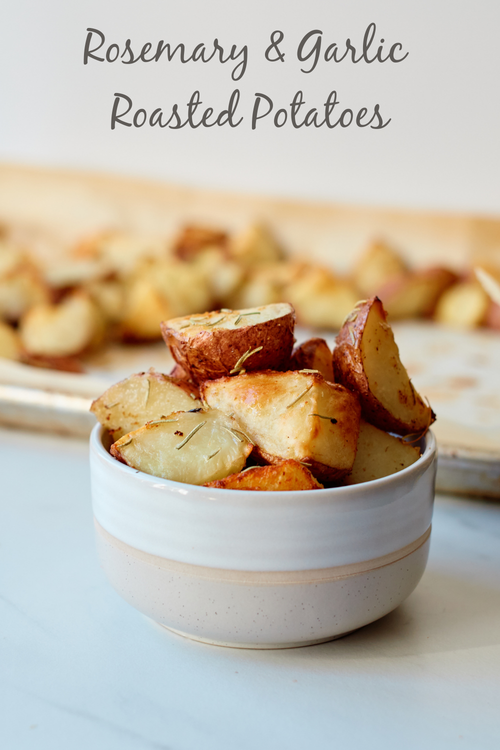 Flavorful rosemary mingles with garlic to make these delicious Roasted Potatoes that are the perfect side dish for any meal.