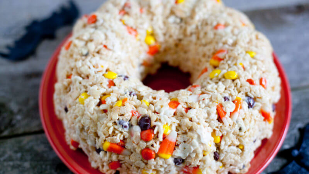 Halloween Rice Krispie Treat Cake sitting on a red plate