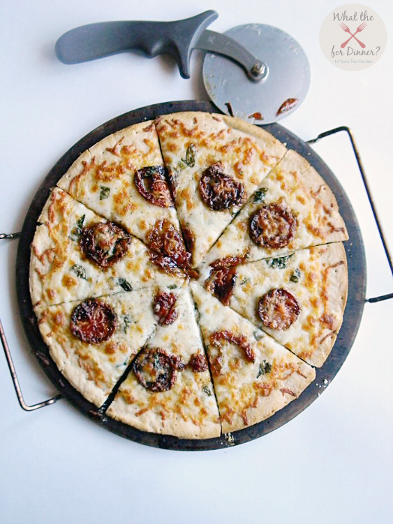 A traditional Margherita Pizza gets a sweet kick with the addition of addictively delicious candied tomatoes