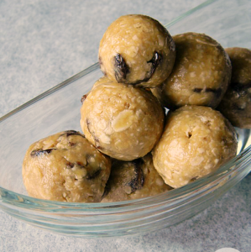 A clear bowl piled with no-bake oatmeal cookie energy balls