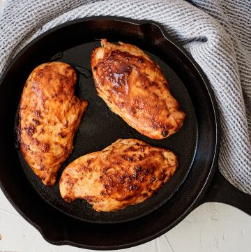 Three Chicken breasts in a cast iron skillet