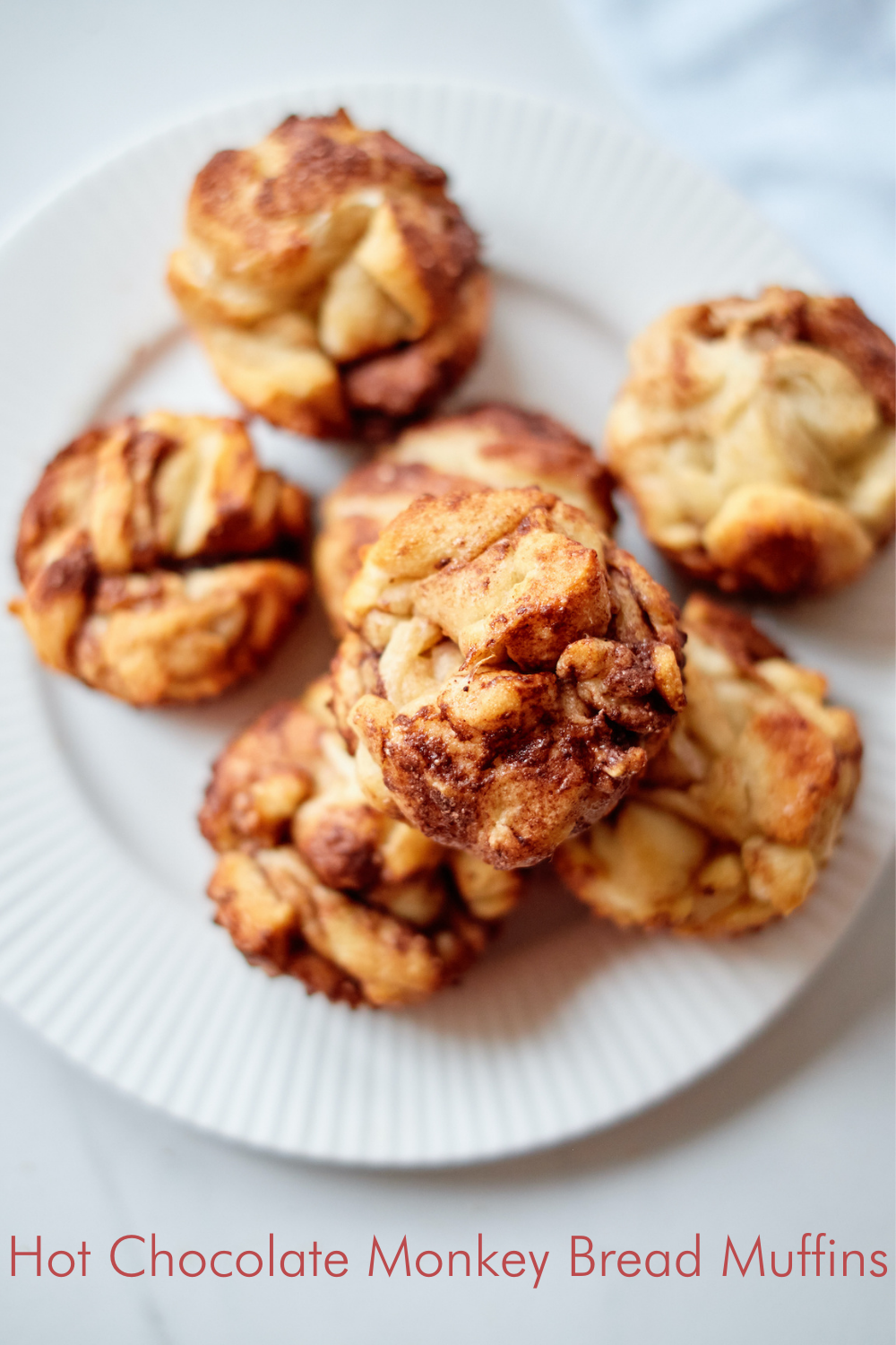 Wow your brunch crowd with this irresistibly sweet and rich take on monkey bread! These easy Monkey Bread Muffins layer dough pieces coated in rich hot chocolate. Get ready to pull apart these Hot Chocolate Monkey Bread Muffins!