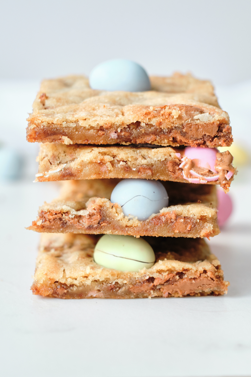 four mini egg cookie bars stacked on top of each other