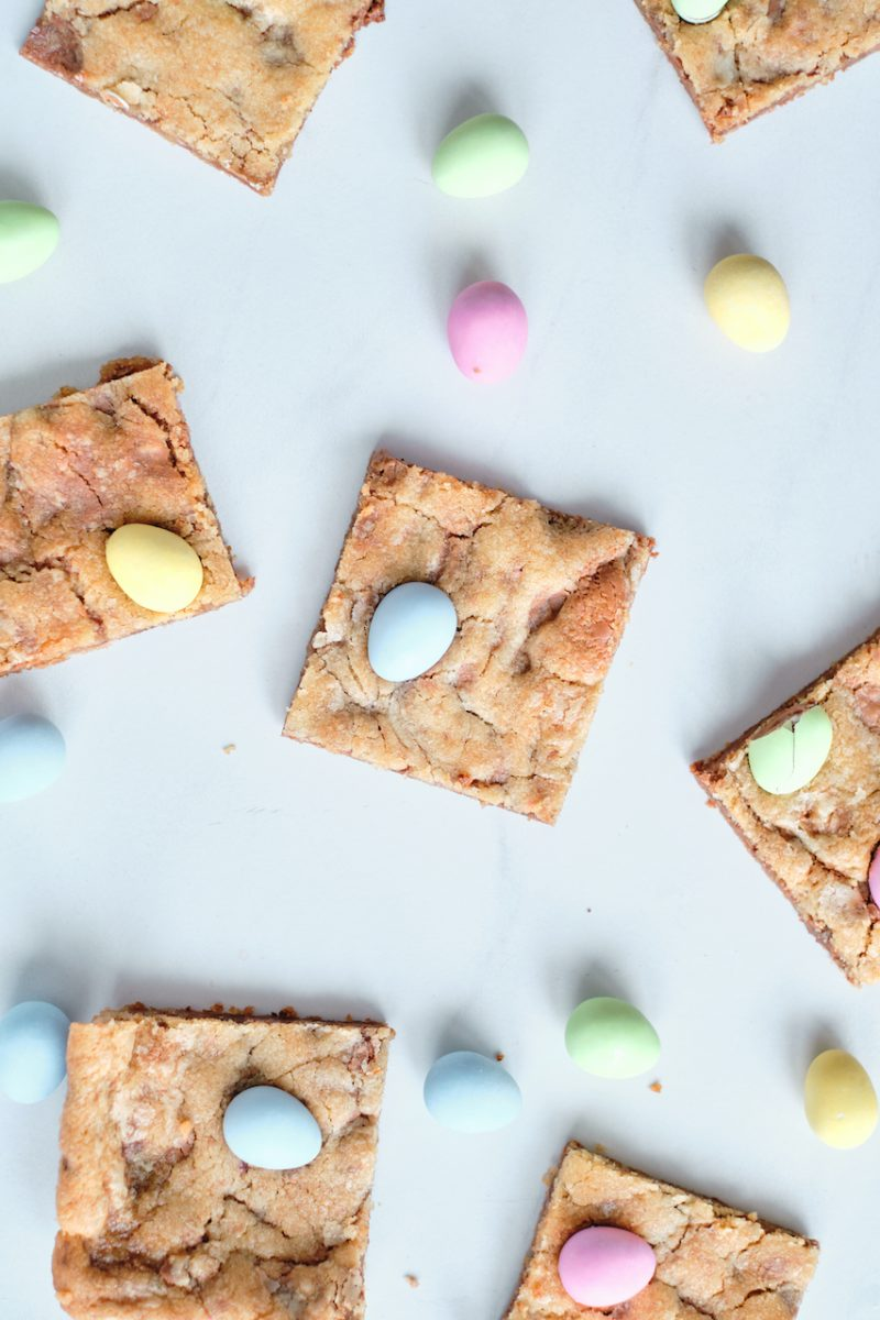 cookie bars on a white background surrounded by mini egg candies